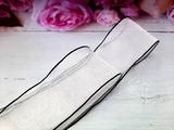 Шифоновая лента цв. молочный с черным краем 38 мм.
