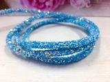 Декоративный силиконовый шнур с пайетками цв. ярко-голубой 6 мм. отверстие - 2мм.(0,5м.)
