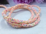 Декоративный силиконовый шнур с пайетками цв. разноцветный светлый 6 мм. отверстие - 2мм.(0,5м.)