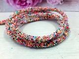 Декоративный силиконовый шнур с пайетками цв. разноцветный яркий 6 мм. отверстие - 2мм.(0,5м.)