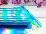 Искусственная кожа голографик цв. голубой 20х30см.