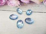 Кабошоны  Rivoli цв. голубой 13х18мм.