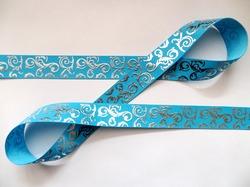 Репсовая лента с серебряным орнаментом цв. голубой 25 мм.