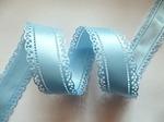 Атласная лента двусторонняя с перфорацией цв. светло-голубой 30 мм.