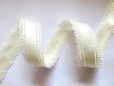 Сатиновая лента двусторонняя с перфорацией цв. молочный 30 мм.