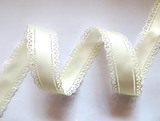 Атласная лента двусторонняя с перфорацией цв. молочный 30 мм.