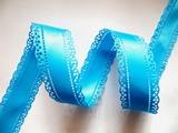 Атласная лента двусторонняя с перфорацией цв. голубой 30 мм.