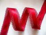Сатиновая лента двусторонняя с перфорацией цв. красный 30 мм.